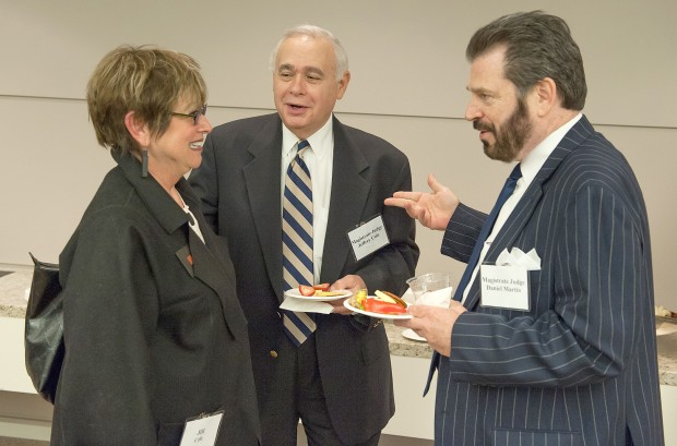 U.S. Magistrate Judge Daniel G. Martin (right) and Jeffrey Cole enjoy hors d'oeuvres as they greet Cole's wife, Jill,
