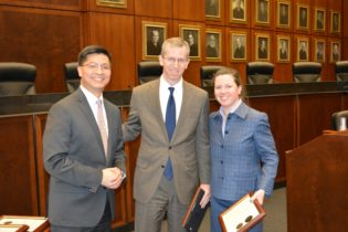 Beth Jantz And Daniel P. McLaughlin Of The Federal Defender Program Receiving An Award For Excellence In Public Interest Service From Judge Edmond E. Chang.